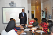 A. Bruce Crawley (standing, center), president, Millennium 3 Management, Inc. (M3M), a Philadelphia-based communications and branding firm, delivers remarks to high school juniors and seniors at a rec