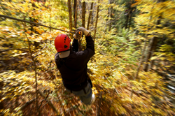 Zip lining in Tennessee through fall foliage