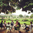 Left Bank Writers Retreat group in discussion amid beautiful Paris scenery.
