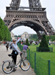 Left Bank Writers Retreat founder Darla Worden visiting the Eiffel Tower on one of her June in Paris writing workshops.