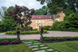 The property includes a manor home, two cottages, a horse barn, tennis court and pool.