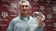 Johnny Manziel with the CFPA Trophy