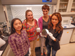 Lawrence Livermore employees Kye Lee, Angela Tooker, Sarah Felix and Vanessa Tolosa hold a silicon wafer containing micromachined implantable neural devices.