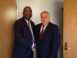 Suffolk County Community College President Shaun L. McKay, Ed.D. and St. Joseph's College President Jack P. Calareso, Ph.D.