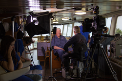 Mercy Ships President and Founder Don Stephens is interviewed by 60 Minutes Correspondent Scott Pelley on the bridge of the Africa Mercy while docked in Togo, West Africa