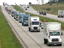 Photo of Line of trucks in the 2014 World's Largest Truck Convoy® for Special Olympics