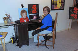 Photo of Barbara DeRuiz in her home art studio.