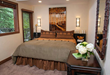 Newly remodeled Platinum-rated bedroom at the Antlers at Vail enjoys walk-out balcony overlooking Gore Creek to make the most of the hotel's scenic Vail, Colorado setting.