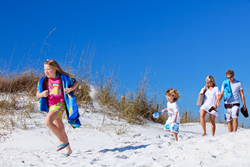 Family enjoying their fall break with a Destin beach vacation