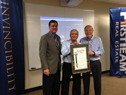 First Team Founder Cameron Merage (center) and longtime Executive Vice President Bill Plattos (right) are presented with a Resolution from the California State Legislature by Assemblyman Don Wagner.