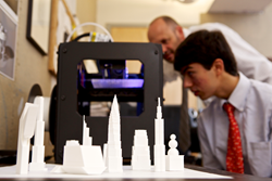 Allan Arp and Nathaniel Bayona '14 examine one of The Hun School's 3D printers.