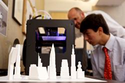 Allan Arp and Nathaniel Bayona '14 examine one of The Hun School's 3D printers.