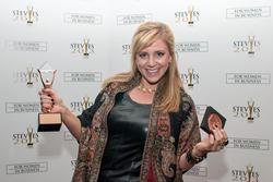 A Stevie Award winner celebrates at last year's awards dinner.