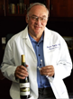 Thomas J. Fogarty, MD, with a bottle of Fogarty wine