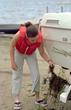 Female Cleaning Boat. Photo Credit: Deborah Rose, MNDNR