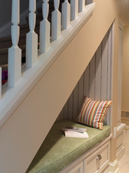 Under Staircase Reading Nook by Case Design/Remodeling, Inc.
