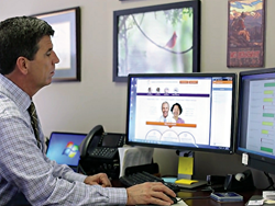 Dr. Jim Walton working on BluePrint's Care Navigator