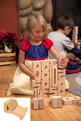 Young Snow White playing with SumBlox Math Building Blocks