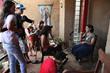 Muriel Hasbun received the 2014 Howard Chapnick grant. Above, Corcoran students and Muriel Hasbun interview Beatriz Deleón about galería el laberinto in El Congo, El Salvado. ©Susan Sterner