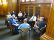 Small groups of managers from both the private and public sectors discuss how to get started applying  Lean philosphy to improve processes their organizations during the CA CI Forum in Sacramento.