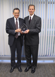 Mark Muskevitsch, Chief Financial Officer (L) and Randy Buening, Vice President of Operations (R) with Deloitte Top 75 Award