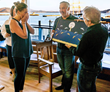 John Kraft presents Dolphin Detour to KIm Chambers at SF Dolphin Club