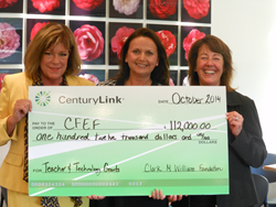 CenturyLink's Melanie Becker presents the check to Consortium of Florida Education Foundations representatives Carman Cullen-Batt, Vice Chair, and Donna Lueders, Chair.