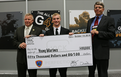Mike Kessler, national executive director and CEO of the Young Marines, and YM/SgtMaj Blake DeWeese, National Young Marine of the Year, gratefully accept a $50,000 donation from Josh Dorsey, VP of GLOCK, Inc.