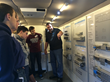 FIRST Robotics teams learning about Festo's eDrive Van.