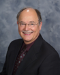 Dr. E. Dale Behner Welcomes Indianapolis, IN Residents with Missing Teeth for Modern Dental Implants