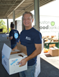 John Held, Omega Protein's Executive Vice President and General Counsel, helps load inspected and sorted food donations for distribution.