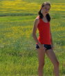 Edmonton model Madeline Tremblay wearing pretty orange yoga tank