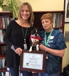 Therapy dog, Kona, receives winner certificate from Pets Best.