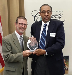 Goodwill Manasota's Robert Rosinsky accepts the 2014 C. John A. Clarke Humanitarian Award from Lakewood Ranch Community Fund board member Dr. Richard Wharton