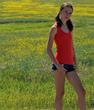 Edmonton model Madeline Tremblay wearing pretty orange yoga tank