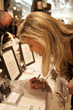 "Diana Sabatino, Owner of DIANA & Company Jewelry Designs and one of Riviera Magazine's Dynamic Women of Orange County, securing a silent auction item at ""Getting to Zero"" Fundraiser"