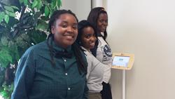 Students Applying for Jobs Using an Apploi Kiosk