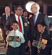 Max Kothari, CEO, Express Kitchens and his sons are congratulated by Harvard Professor Michael Porter at Inner City Awards ceremony held in Boston.