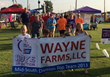 The Wayne Farms Decatur complex walking their first team lap for the 2014 Relay for Life event.