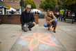 Ossining Village Manager Richard Leins and Ingrid Richards, Manager of Downtown & Economic Development, at the Village of Ossining's First Annual Chalk It Up! Festival held recently at Market Square