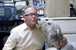 Dr. Gary Johnson gets a kiss from a very happy patient at Dana Niguel Veterinary Hospital.