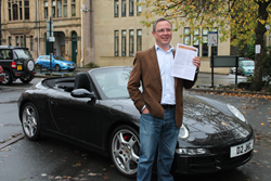 James Cartwright, Managing Director of Direct Gap in Hebden Bridge, with his new car GAP insurance policy
