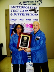 Jim Federico, president of NJ METin Clifton NJ, presenting Chanchal Patel' with a plaque for her 25th service anniversary.