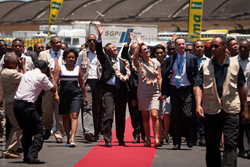 President of Madagascar, Hery Martial Rakotoarimanana Rajaonarimampianina and his wife, Lalao Rajaonarimampianina, wave to crew of the Africa Mercy at the Arrival Ceremony.