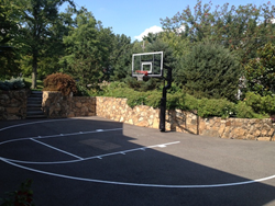 Basketball Hoop in front of Retaining Wall
