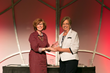 Care Net's Cynthia Hopkins Presents Jean Killough With Best Welcoming Environment Award for Beltway 8 South CPC