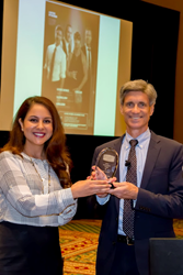 Dr. Frank Longo receives 2014 Achievement Award in Brain Science from Lily Sarafan, President of Home Care Assistance