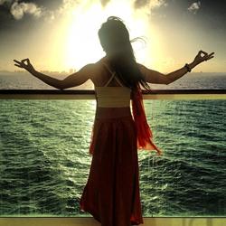 The Zen Cruise 2014 guest Jessica Stiehm overlooking the ocean at sunset (credit: Aaron Erickson)