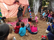 A storyteller entertains kids at this school fundraiser in Altadena, California for the Pasadena Waldorf School.