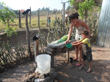 A sponsored family in Honduras washes clothes with water collected from a river nearby.